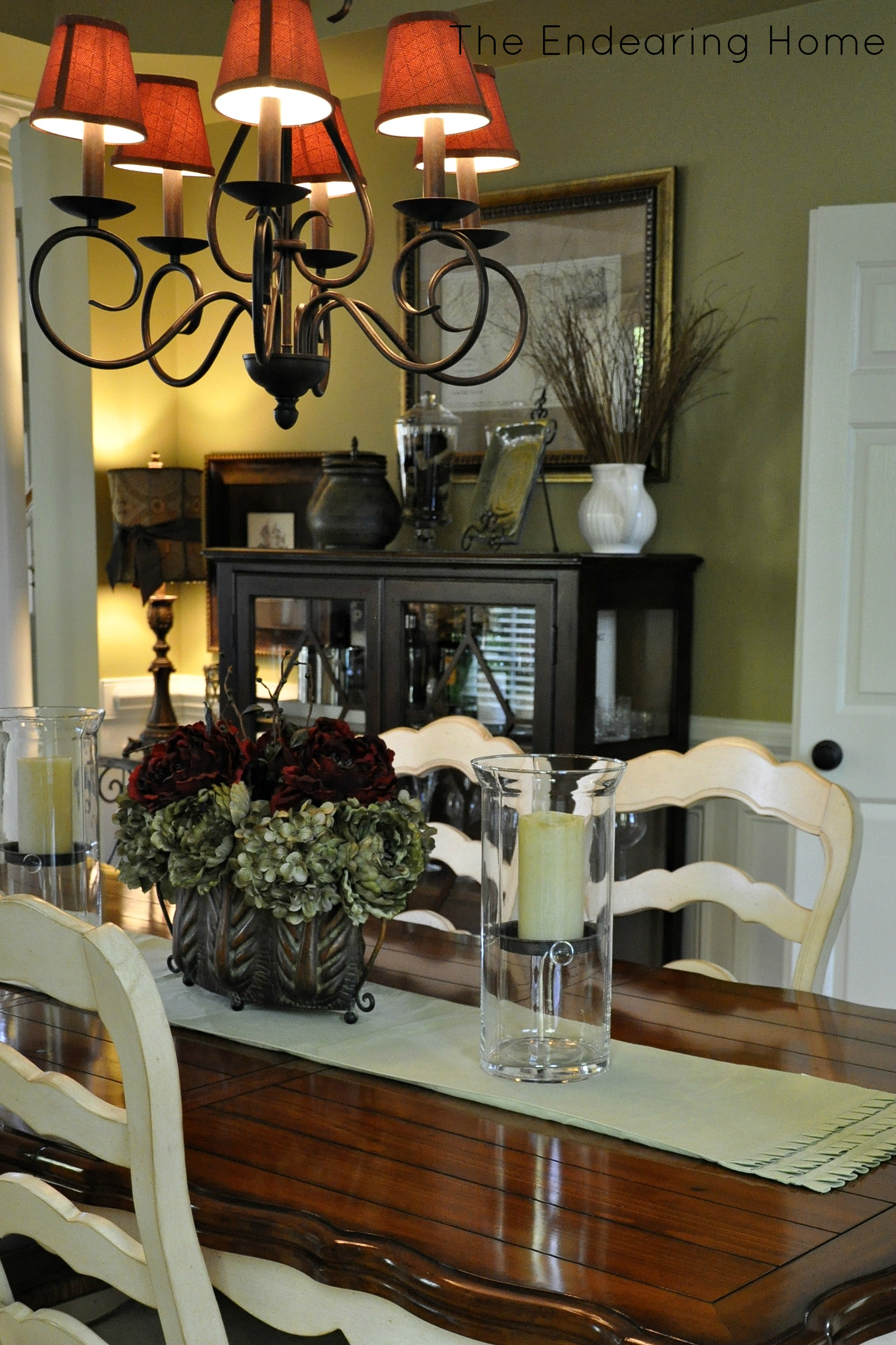 Below Is A Picture Of The Dining Room On Move In Day To Update We Changed Chandelier Ballard Designs Curtain Rods Lowes Door Knobs And